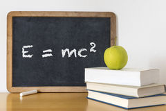 Learning Physics. Still life with apple and blackboard Royalty Free Stock Photos