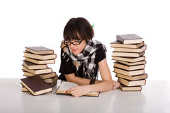 Learning and reading between two pile of books Stock Image