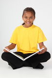Learning by reading for young school girl 10 in ye Stock Photo