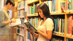 Learning students reading books. In a library stock footage
