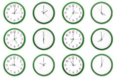 Learning time - odd numbers, green. 12 clocks isolated on a white background. Each one showing one hour of the day. The odd numbers are outstanding Royalty Free Stock Photo