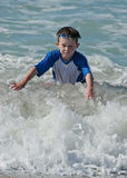 Learning to body surf Stock Images