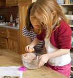 Learning to Break an Egg. Royalty Free Stock Images