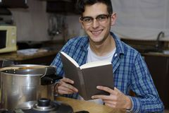 Learning to cook with cookbook stock photography