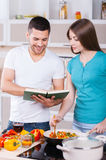 Learning to cook together. Royalty Free Stock Photos