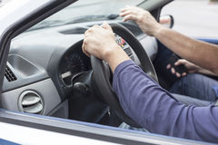 Learning to drive a car. Close up of woman's hand driving a car Royalty Free Stock Photos