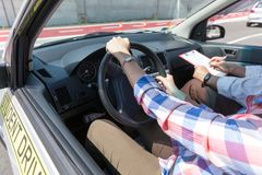 Learning to drive a car with a driving instructor. Learning to drive a car Stock Images