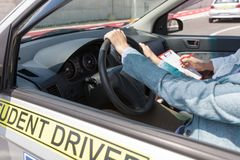 Learning to drive a car with a driving instructor. Student drive. Learning to drive a car. Driving school Royalty Free Stock Photography