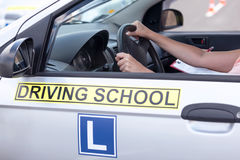 Learning to drive a car. Driving school. Stock Images