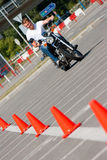 Learning to drive a motorcycle. Young man learning to drive a motorcycle Royalty Free Stock Photography