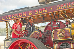 Learning to drive a vintage  Traction engine. A young man learning to drive a Vintage Steam Traction Engine at the Roseisle Vintage Rally held on 22 nd September Royalty Free Stock Images