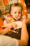 Learning to eat - dirty baby Stock Image