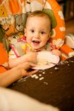 Learning to eat - dirty baby Stock Photography