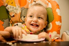 Learning to eat - dirty baby Stock Images