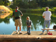 Learning to fish from dad and uncle Joe Royalty Free Stock Image