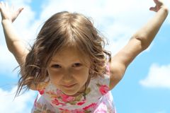 Learning to fly. Young girl spreading her wings just like bird learning to fly Stock Images