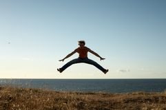 Learning to fly. Sporty man jumping Stock Image