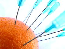 Learning to give injections. Practicing on oranges in giving injections Royalty Free Stock Photo