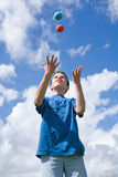 Learning to juggle. (some motion blur Stock Image