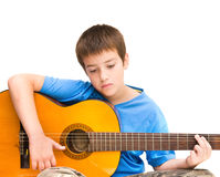 Learning to play acoustic guitar royalty free stock images