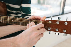 Learning to play the guitar. Music education. Royalty Free Stock Image