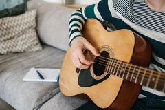 Learning to play the guitar. Music education. Royalty Free Stock Images