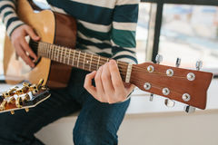 Learning to play the guitar. Music education and extracurricular lessons. Stock Images