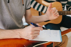 Learning to play the guitar. Music education and extracurricular lessons. Stock Photos