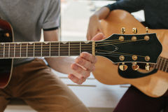 Learning to play the guitar. Music education and extracurricular lessons. Royalty Free Stock Photography