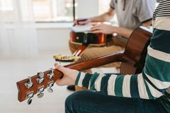 Learning to play the guitar. Music education and extracurricular lessons. Hobbies and enthusiasm for playing guitar and. Singing songs. To have fun royalty free stock image