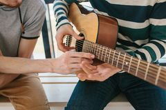 Learning to play the guitar. Music education and extracurricular lessons. Hobbies and enthusiasm for playing guitar and. Singing songs. To have fun stock photos