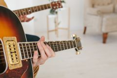 Learning to play the guitar. Music education and extracurricular lessons. Hobbies and enthusiasm for playing guitar and. Singing songs. To have fun stock images