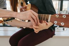 Learning to play the guitar. Music education and extracurricular lessons.  royalty free stock photo