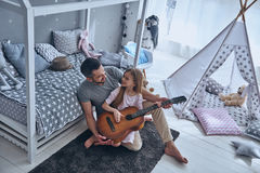 Learning to play guitar. Royalty Free Stock Images