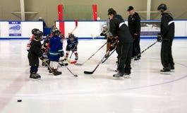 Learning to play hockey stock photo