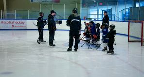 Learning to play hockey Royalty Free Stock Photo