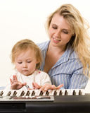 Learning to play keyboard Stock Photography