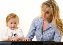 Learning to play keyboard Royalty Free Stock Image