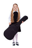 Learning to play a musical instrument - little girl with guitar Royalty Free Stock Photo
