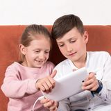 Learning to play on the tablet Royalty Free Stock Photo