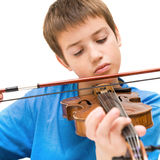 Learning to play violin stock image
