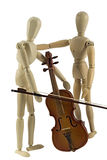 Learning to play the violin. A wooden mannequin learning how to play the violin Stock Photo