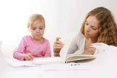 Learning to read. Kid - activity in preschool - over white Royalty Free Stock Photography