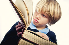 Learning to read. Portrait of a boy learning to read Stock Image
