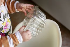 Baby learnig to recycle Stock Image