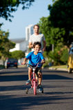 Learning to ride bicycle royalty free stock photos