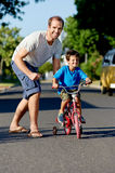 Learning to ride bicycle Stock Image