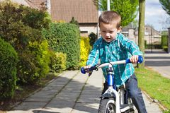 Learning to ride on a bike Stock Photos