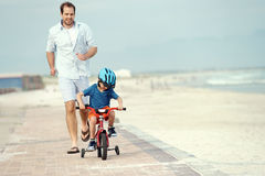 Learning to ride a bike Stock Images