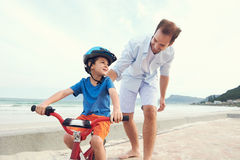 Learning to ride a bike Stock Image